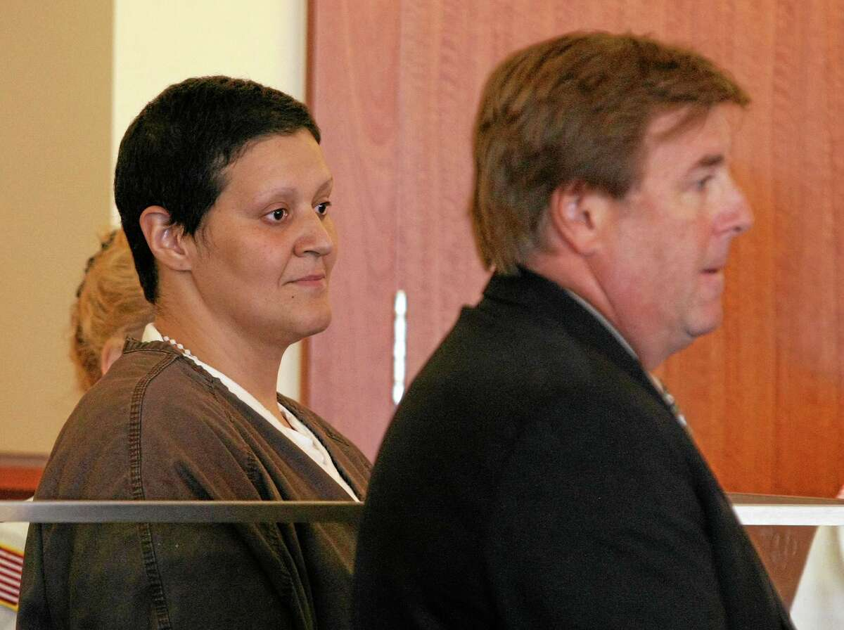 Tanya Singleton, left, and her attorney Peter Parker, are seen in Fall River Superior Court Monday morning, Sept. 30, 2013. Singleton, a cousin of former New England Patriots tight end Aaron Hernandez pleaded not guilty to a conspiracy charge for her alleged actions following the killing of Hernandez's friend. (AP Photo/The Boston Globe, George Rizer, Pool)