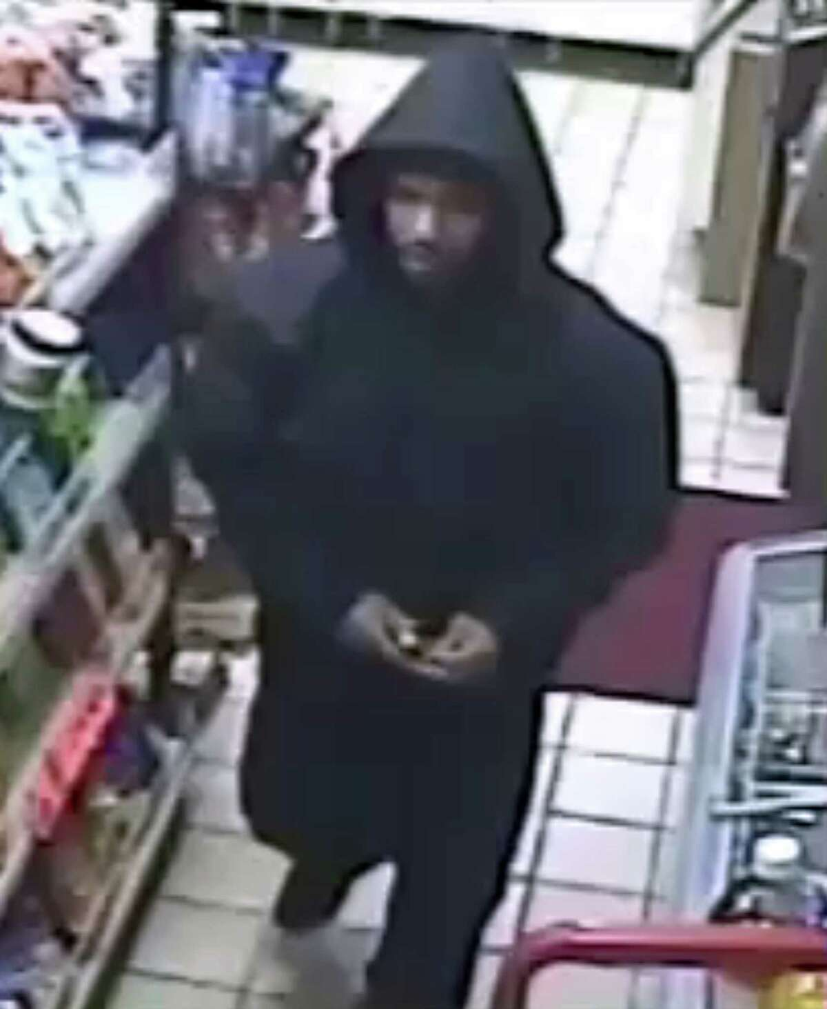 This image taken from video released by the Philadelphia Police Department on Tuesday, Nov. 4, 2014, shows the suspect at a gas station mini-mart in Aberdeen, Md.