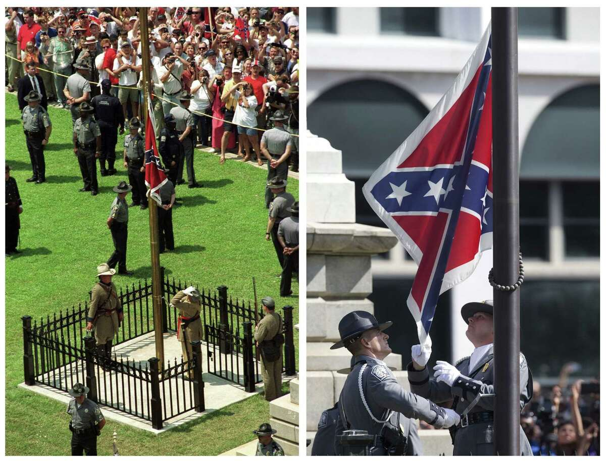 FILE - In this photo combination, the Confederate battle flag is raised in front of the South Carolina Statehouse in Columbia, S.C., on July 1, 2000, left, and the same flag is taken down on July 10, 2015, right, ending its presence on the Capitol grounds. The flagís removal seemed unthinkable before the June 17 massacre of nine black parishioners at a Charleston church during a Bible study. Dylann Roof, a white man who was photographed with the Confederate flag, is charged in the shooting deaths, and authorities have called the killings a hate crime. (AP Photo/Paula Illingworth, left, John Bazemore, right)