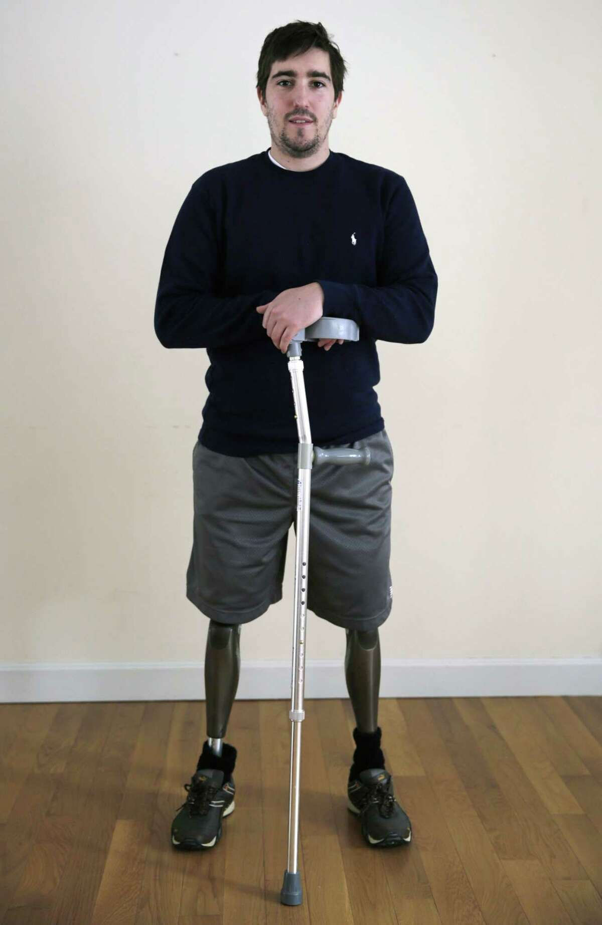 FILE - In this March 14, 2014 file photo, Jeff Bauman stands in his home in Carlisle, Mass. Bauman, who lost both of his legs in the Boston Marathon bombings, testified Thursday, March 5, 2015, in the federal death penalty trial of Dzhokhar Tsarnaev in Boston. Tsarnaev is charged with conspiring with his brother to place twin bombs near the finish line of the race, killing three and injuring 260 people. (AP Photo/Charles Krupa, File)