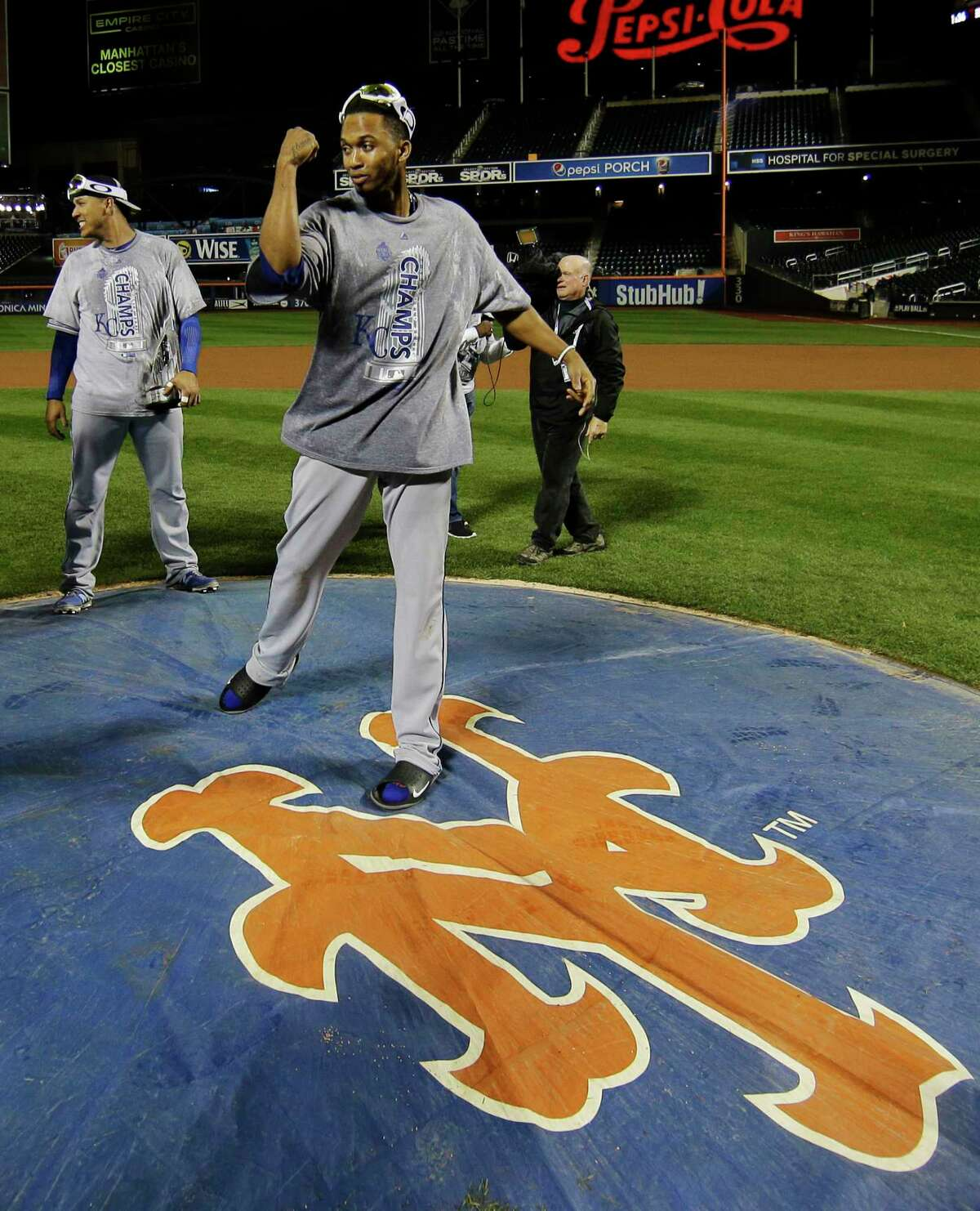 Kansas City Royals shortstop Alcides Escobar poses on the New York Mets logo after Game 5 of the World Series Monday night in New York.