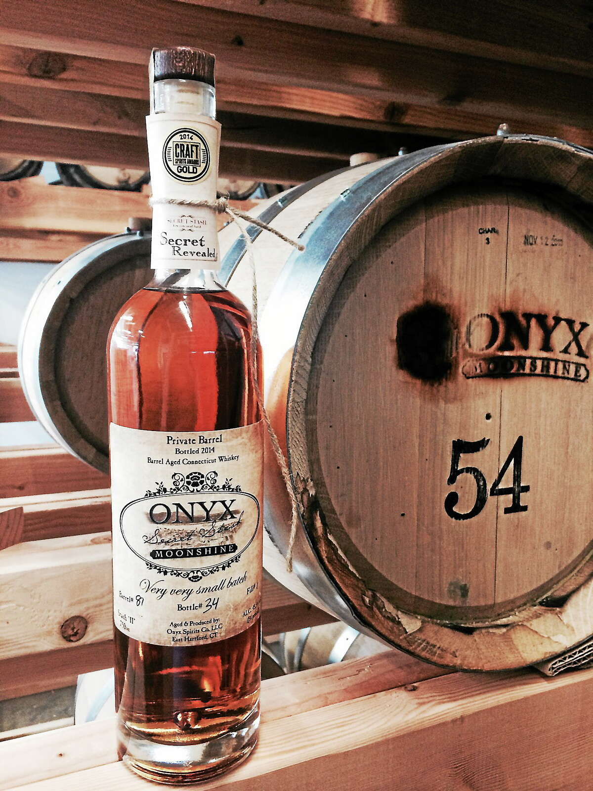 The Onyx Spirits Co. has re-released the state's first barrel-aged whiskey, Secret Stash, with an etching of a Middletown High School art teacher's historical painting of the city's riverfront as it looked 115 years ago.
