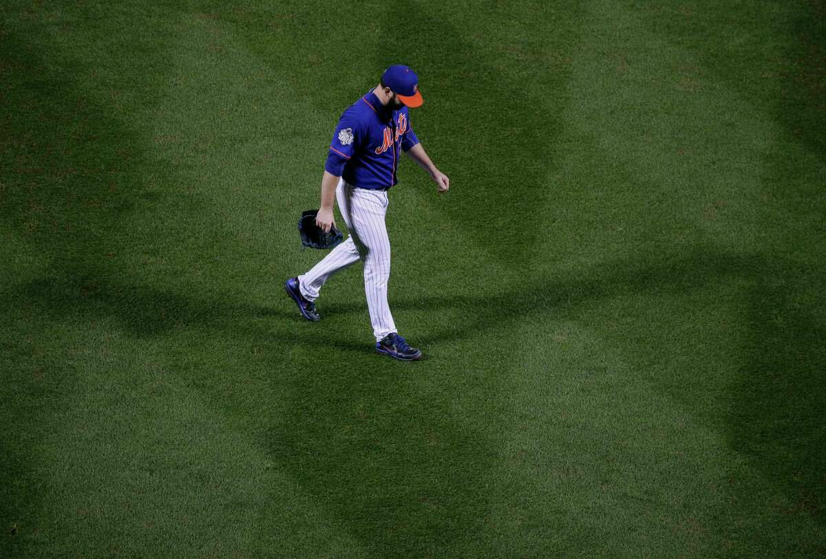 Mets starting pitcher Matt Harvey leaves the game against the Kansas City Royals during the ninth inning of Game 5 of the World Series on Sunday night in New York.