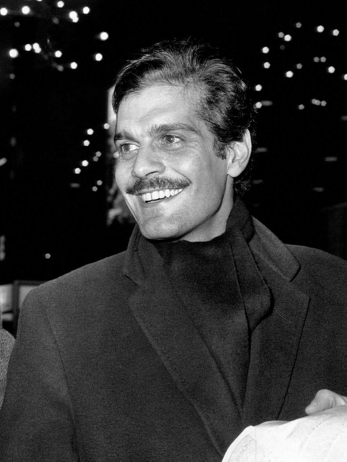 In this Jan. 3, 1963, file photo, Egyptian actor Omar Sharif smiles on his arrival at London Airport. Sharif has died in a Cairo hospital of a heart attack, his agent said on Friday, July 10, 2015.