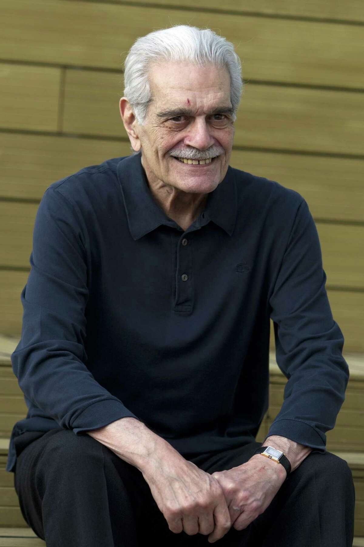 """In this Thursday, Nov. 24, 2011, file photo, actor Omar Sharif poses during a photo call for the """"Medfilm, Mediterranian Film Festival"""" lifetime achievement award, in Rome. Sharif has died in a Cairo hospital of a heart attack, his agent said on Friday, July 10, 2015."""