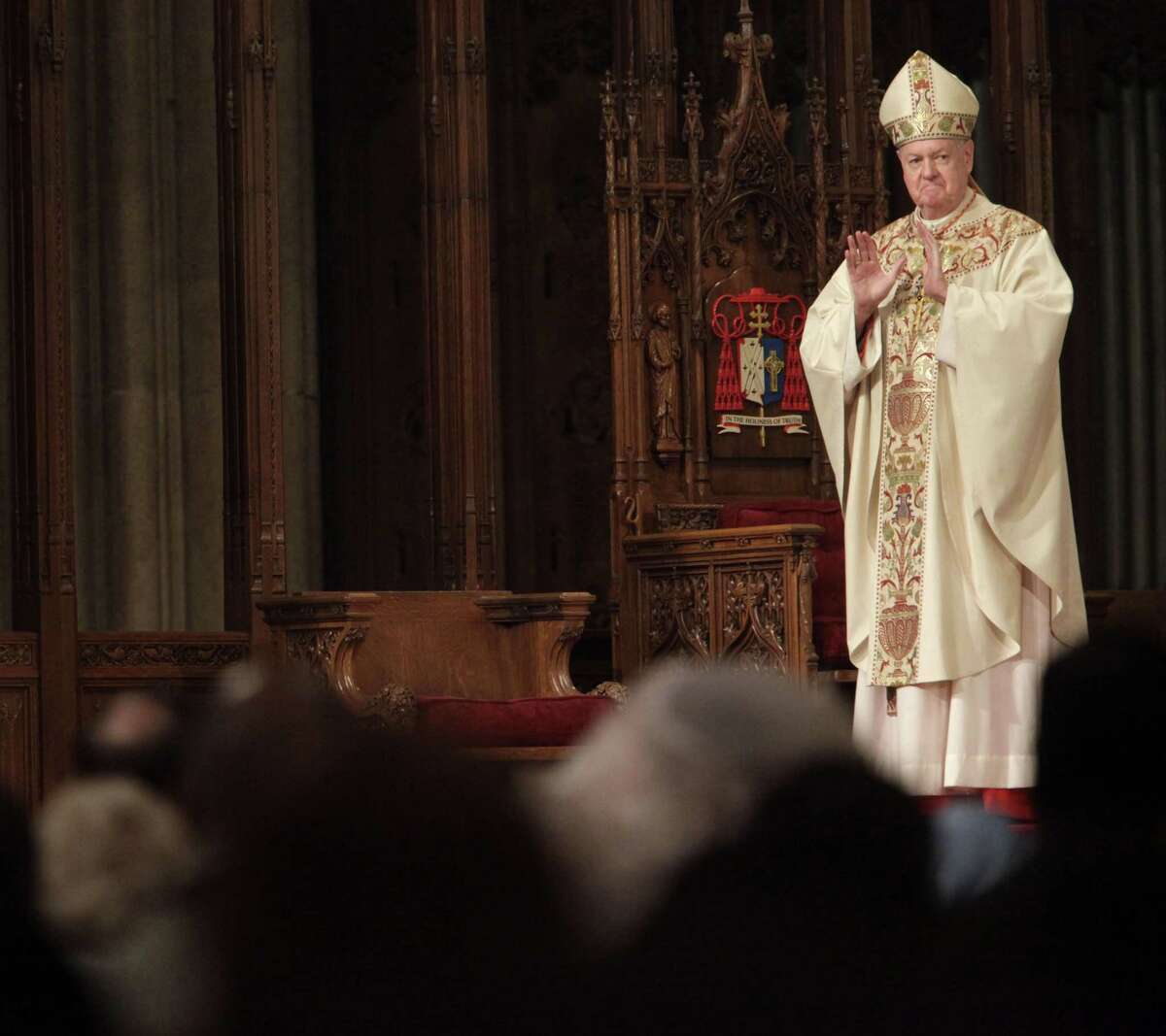 FILE- In this April 12, 2009 file photo, Cardinal Edward Egan receives a standing ovation after speaking to worshipers during Easter Mass in New York. Egan, the former archbishop of New York, died of cardiac arrest Thursday, March 5, 2015, in New York. He was 82.
