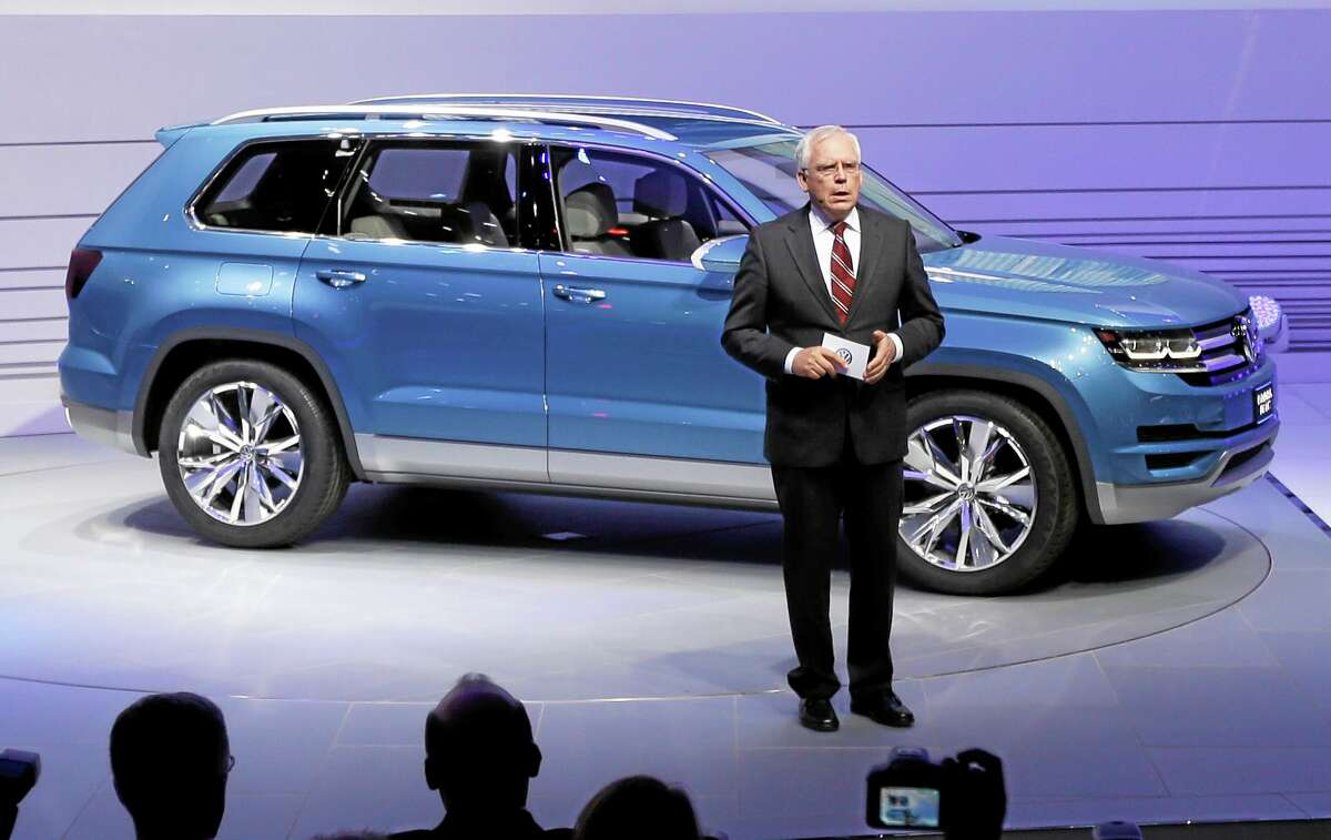 In this Jan. 14, 2013, photo, Ulrich Hackenberg, Volkswagen director of produce development for power trains, stands next to the Volkswagen CrossBlue SUV concept vehicle during the North American International Auto Show in Detroit.