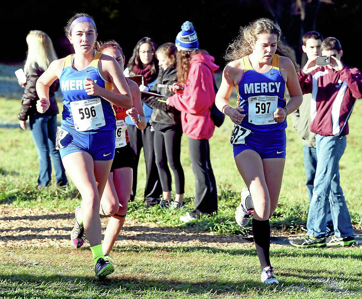 Mackenzie Pias (left) and Bridgid Selfors (right) of Mercy finished first and second, respectively, in the Class L Girls CIAC Championship at Wickham Park in Manchester this weekend.
