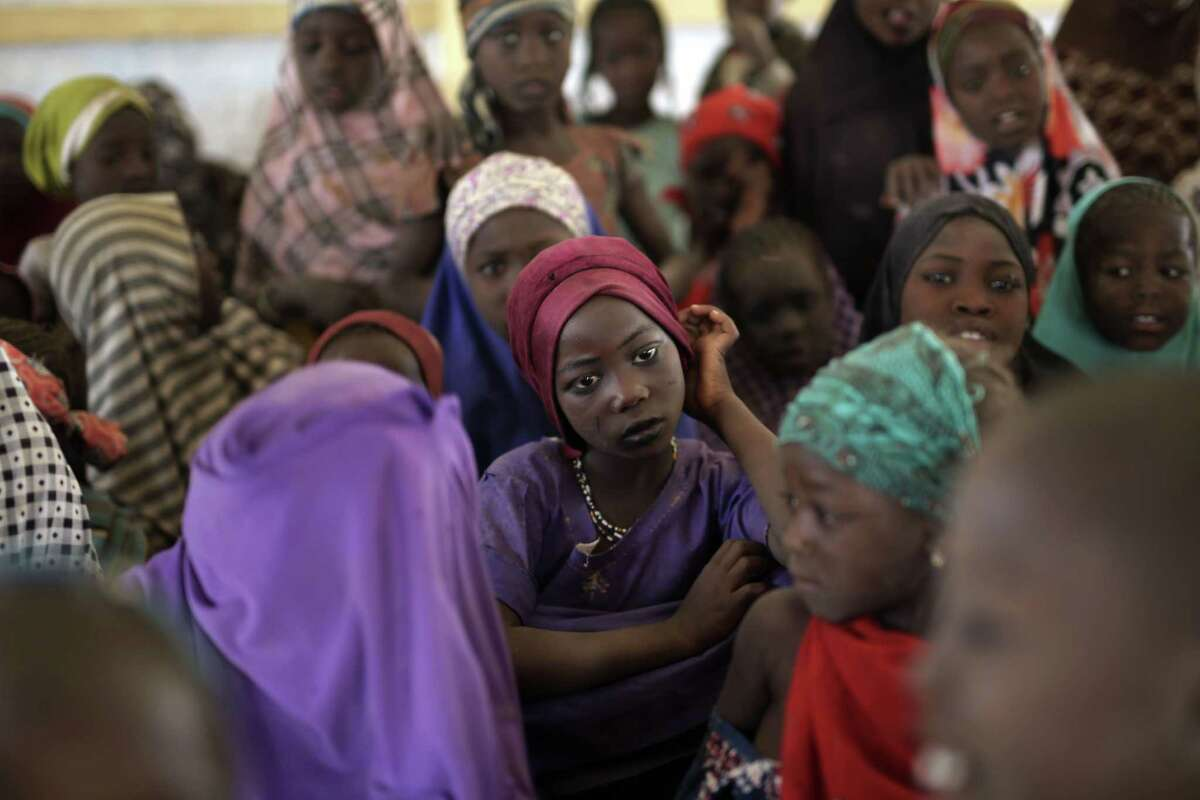 Nigerian girls who fled Boko Haram to Chad gather in a school set up by UNICEF at the Baga Solo refugee camp in Chad, Wednesday March 4, 2015. The camp, jointly run by the Chadian government and the United Nations refugee agency UNHCR, opened in January 2015 and hosts over 6,000 refugees. Many families have been divided and Chadian authorities believe more than 2,000 people remain trapped on islands in Lake Chad, which borders Chad, Nigeria and parts of Cameroon and Niger. (AP Photo/Jerome Delay)