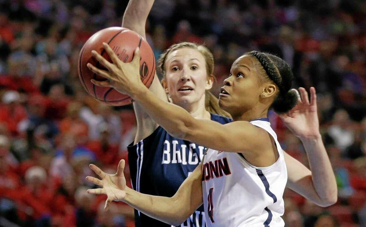 UConn's Moriah Jefferson (4) goes for a layup against BYU's Jennifer Hamson on Saturday.