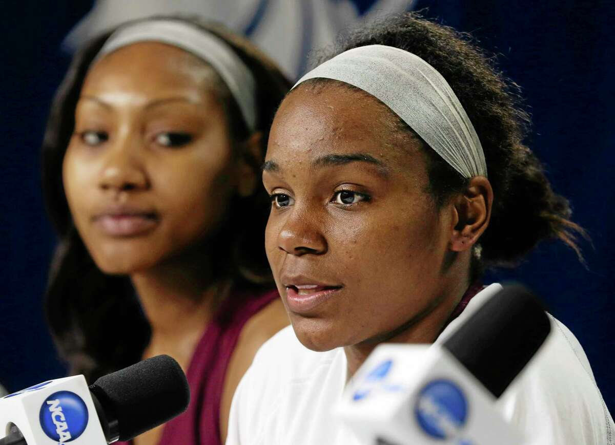 Texas A&M's Jordan Jones, right, speaks during a news conference on Saturday.
