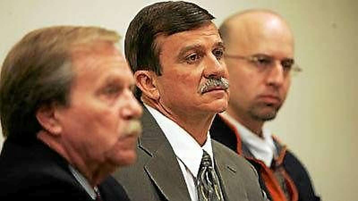 In 2009, David Messinger, center, shown flanked by his lawyers, Michael Devlin, left, and John Geida, right, listens to testimony during his appearance before the Connecticut Psychiatric Security Review Board at Connecticut Valley Hospital in Middletown.