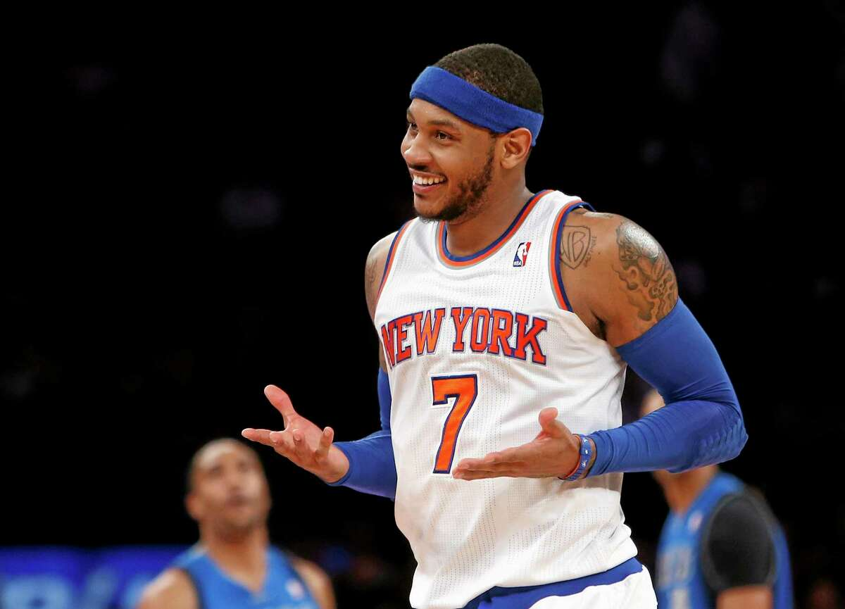 """Carmelo Anthony is staying in New York. He announced his decision Sunday in a posting titled """"My City, My Heart"""" on his website."""