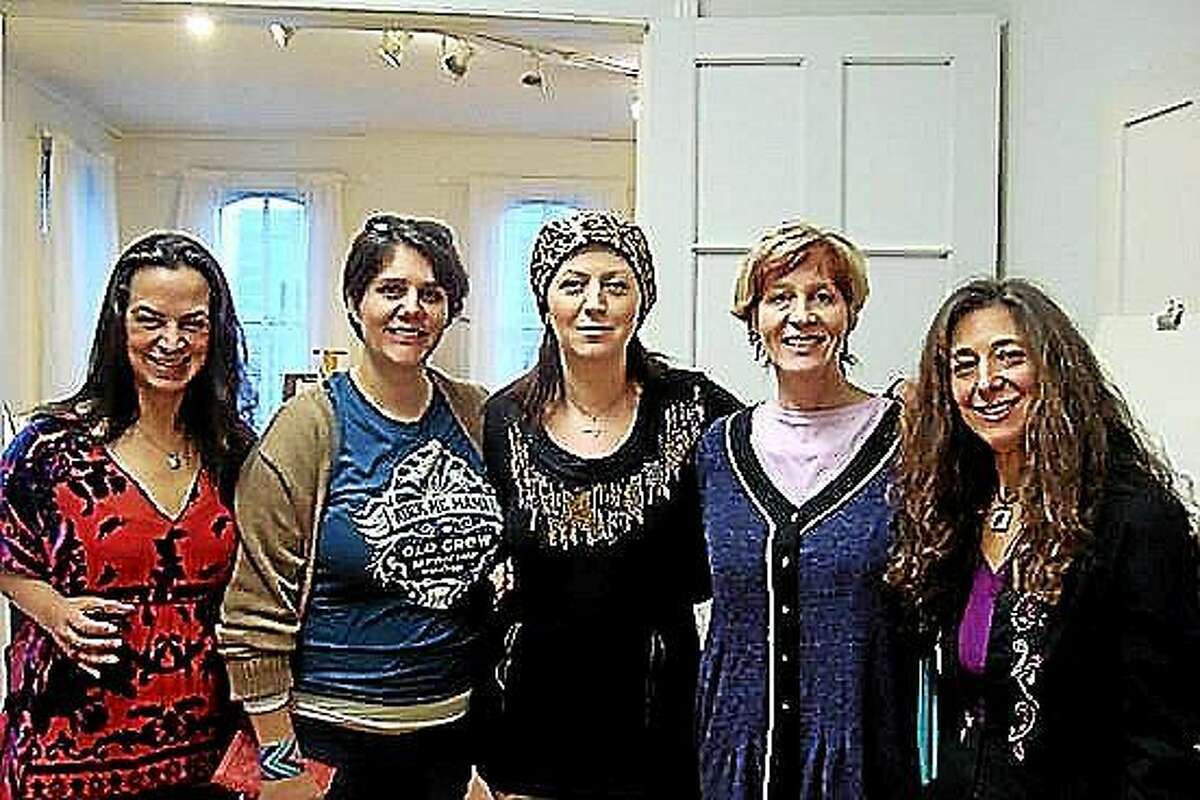 The 2014 International Women's Day event speakers pose at the Middletown Art Academy (from left) JCherry, Bobby Knoll, Rusa D'Alessandro, Elizabeth McKenty and Dina Abramo Pratt.