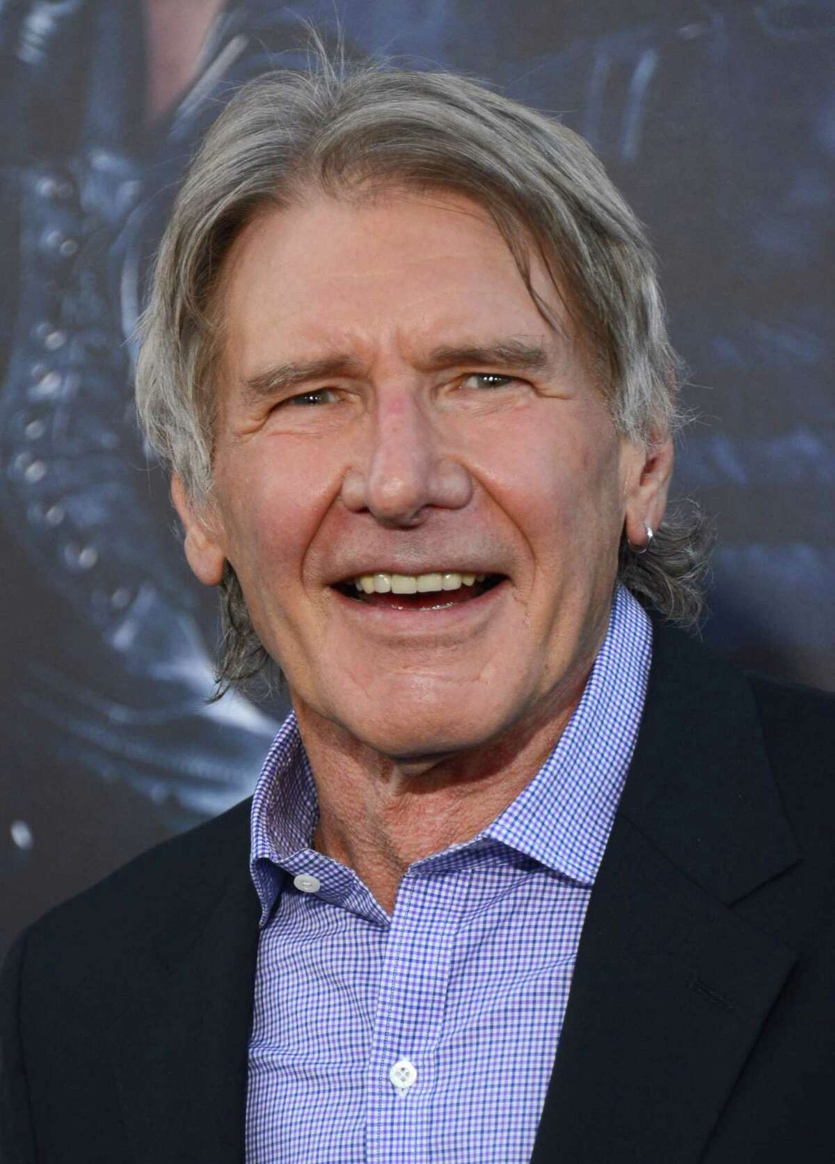 """FILE - In this Monday, Aug. 11, 2014 file photo, Harrison Ford arrives at the premiere of """"The Expendables 3"""" at TCL Chinese Theatre in Los Angeles. An official says Ford crash-landed his vintage airplane at a Los Angeles golf course. He suffered moderate injuries."""