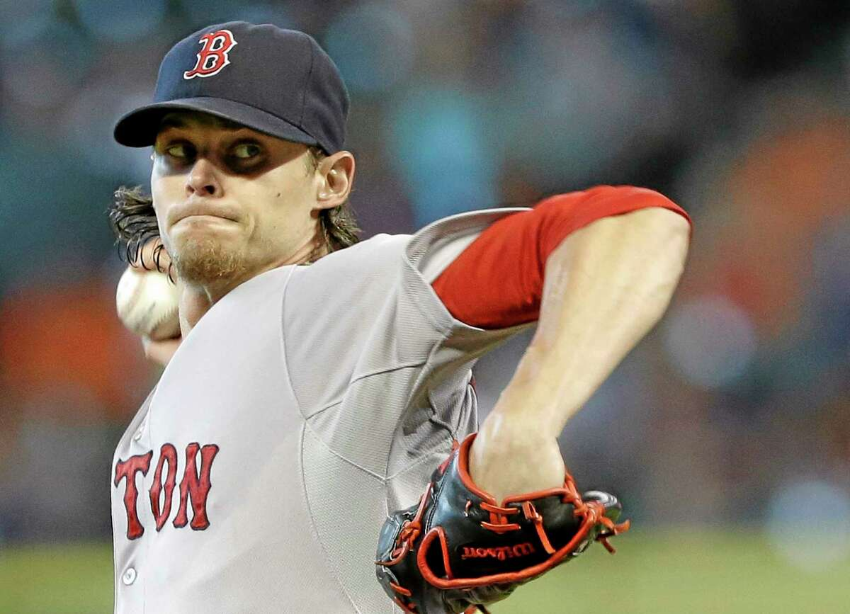 Clay Buchholz delivers a pitch against the Houston Astros in the first inning Sunday.