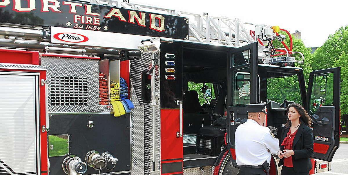 Christie Carpino and a Portland fire official.