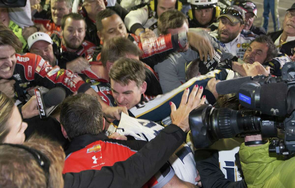 Jeff Gordon is in the middle of a fight after the NASCAR Sprint Cup Series race on Sunday at Texas Motor Speedway in Fort Worth, Texas. The crews of Gordon and Brad Keselowski fought after the race.
