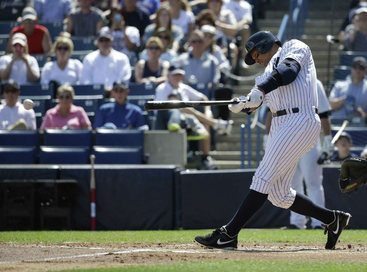 New York Yankees designated hitter Alex Rodriguez hits a single in the first inning during a spring training game against the Philadelphia Phillies on Wednesday in Tampa, Fla.