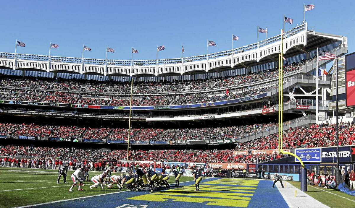 Notre Dame and Rutgers play during the Pinstripe Bowl at Yankee Stadium on Dec. 28, 2013.