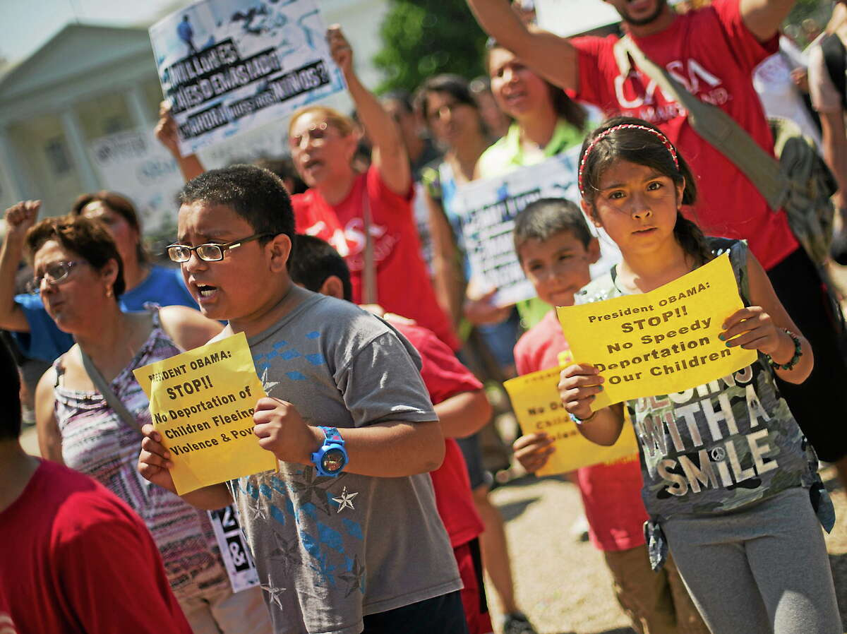 Alexandria Diaz, 9, from Baltimore, Md., joins her parents during a march in front of the White House in Washington on July 7, 2014, following a news conference of immigrant families and children's advocates responding to the President Barack Obama's response to the crisis of unaccompanied children and families illegally entering the U.S.