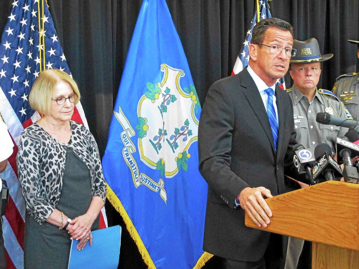 Connecticut Gov. Dannel P. Malloy, front right, discusses a decrease over the previous year in violent crime in the state on Sept. 28, 2015 in Middletown, Conn.