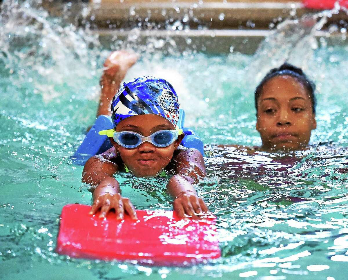 The pool at LEAP has reopened to teach LEAP children to swim. This class was for 7-8 year old girls. Nevaeh Lowery, age 8, motors along practicing her kick under the watchful gaze of instructor Kyla Sead July 8 in New Haven.