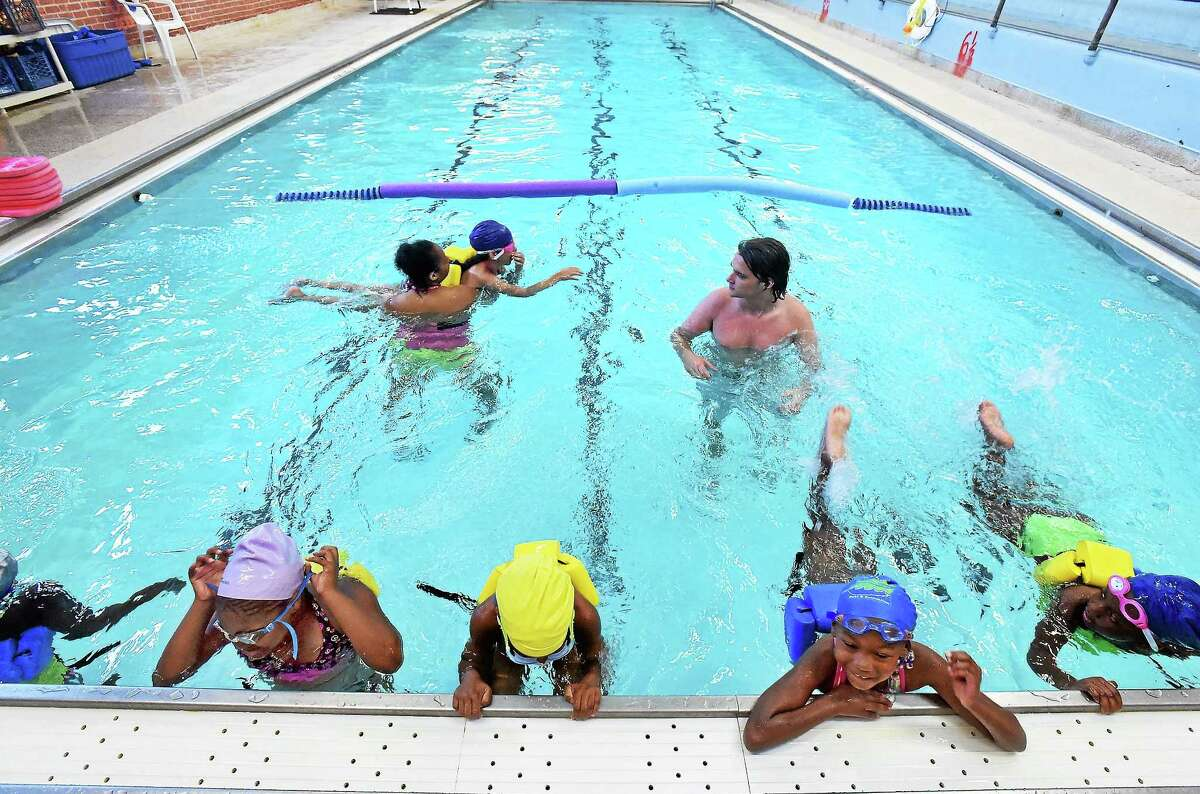 The pool at LEAP has reopened to teach LEAP children to swim. This class was for 7-8 year old girls and was taught by Kyla Sead, left, and Ryan Rittendale July 8 in New Haven..