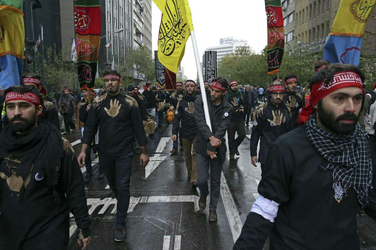 Iranians chant slogans during an anti-U.S. demonstration in front of the former U.S. Embassy, during Ashoura, when Muslim Shiites mark the death of 7th century Imam Hussein, in Tehran, Iran, Tuesday, Nov. 4, 2014. Thousands of Iranians chanted ìDown with Americaî at an anti-U.S. rally on Tuesday marking the anniversary of the 1979 takeover of the U.S. Embassy in Tehran, just days ahead of a key meeting between the two nationsí top diplomats over Iranís controversial nuclear program. (AP Photo/Vahid Salemi)