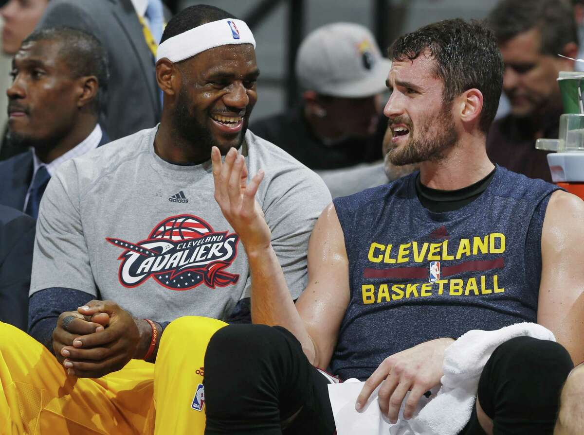LeBron James, left, here with teammate Kevin Love, agreed to a one-year, $23 million contract with the Cleveland Cavaliers which includes a player option for 2016-17.