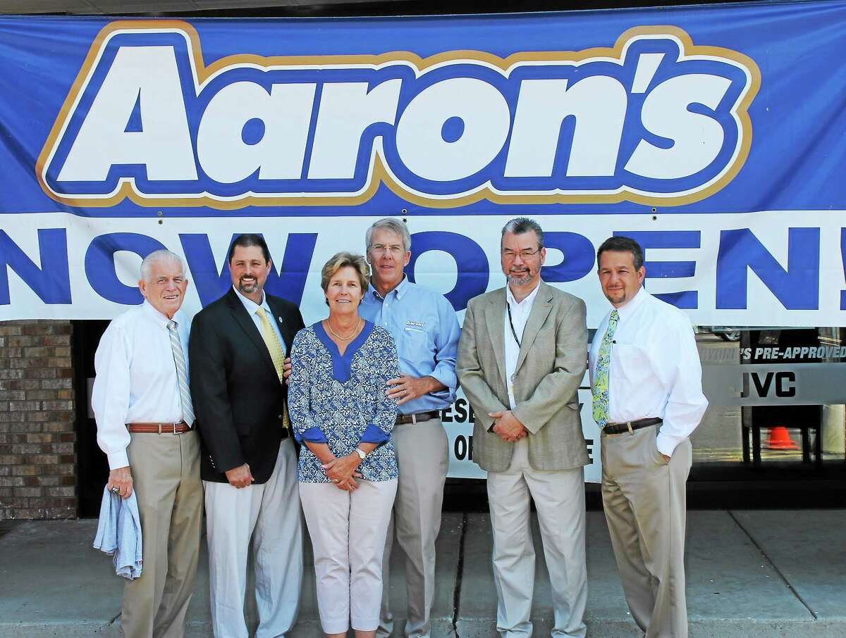 From left are Middlesex County Chamber President Larry McHugh, Cromwell Mayor Enzo Faienza, Anne Carlson, Aaron's Franchise Owner Steve Carlson, Aaronís of Cromwell General Manager Mike Robinson, Chamber Chairman Rich Carella