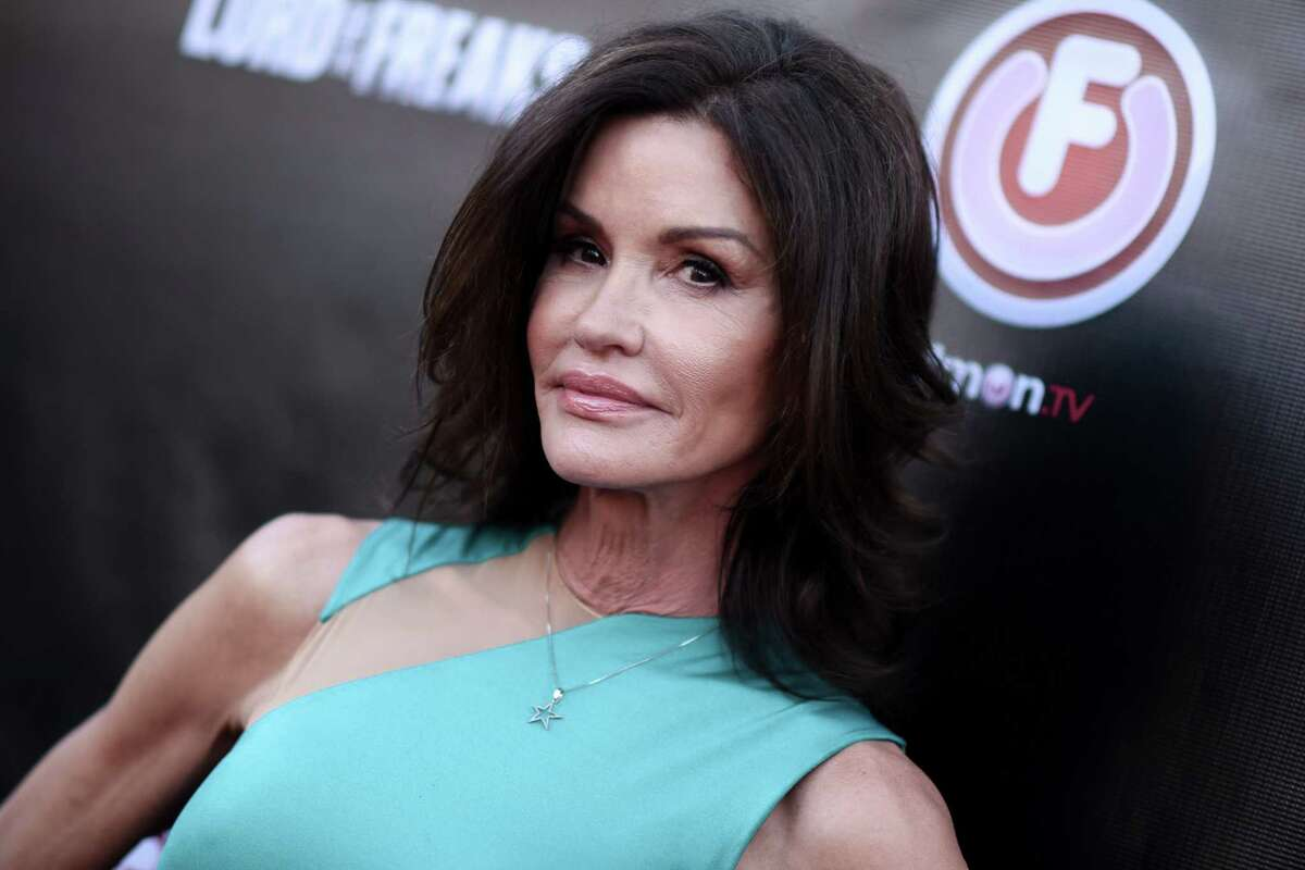 """In this June 29, 2015 photo, Janice Dickinson arrives at the LA Premiere of """"Lord of the Freaks"""" in Los Angeles."""