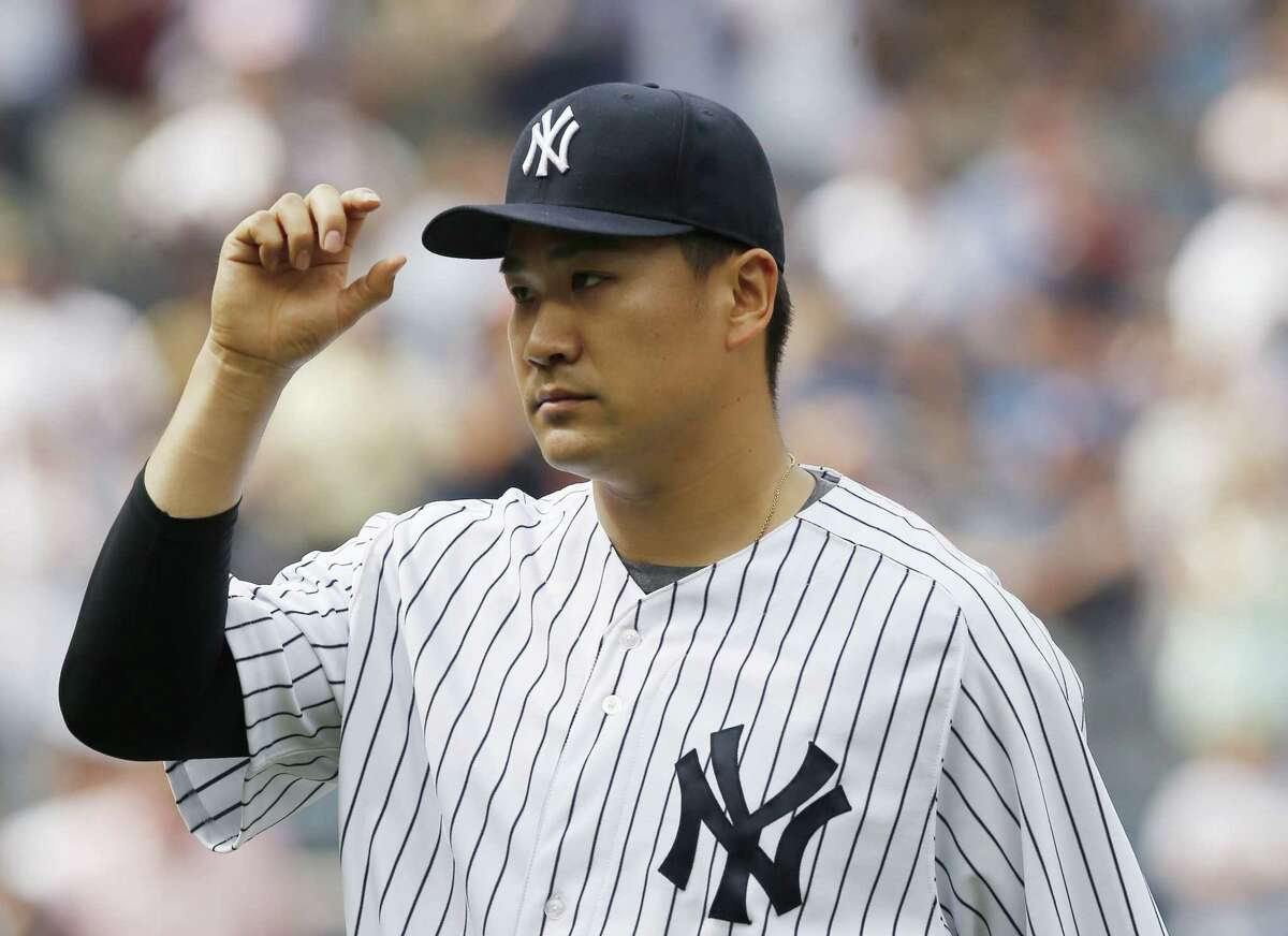 New York starter Masahiro Tanaka tips his cap during the eighth inning of the Yankees' 6-2 victory over the Oakland Athletics on Thursday in the Bronx.