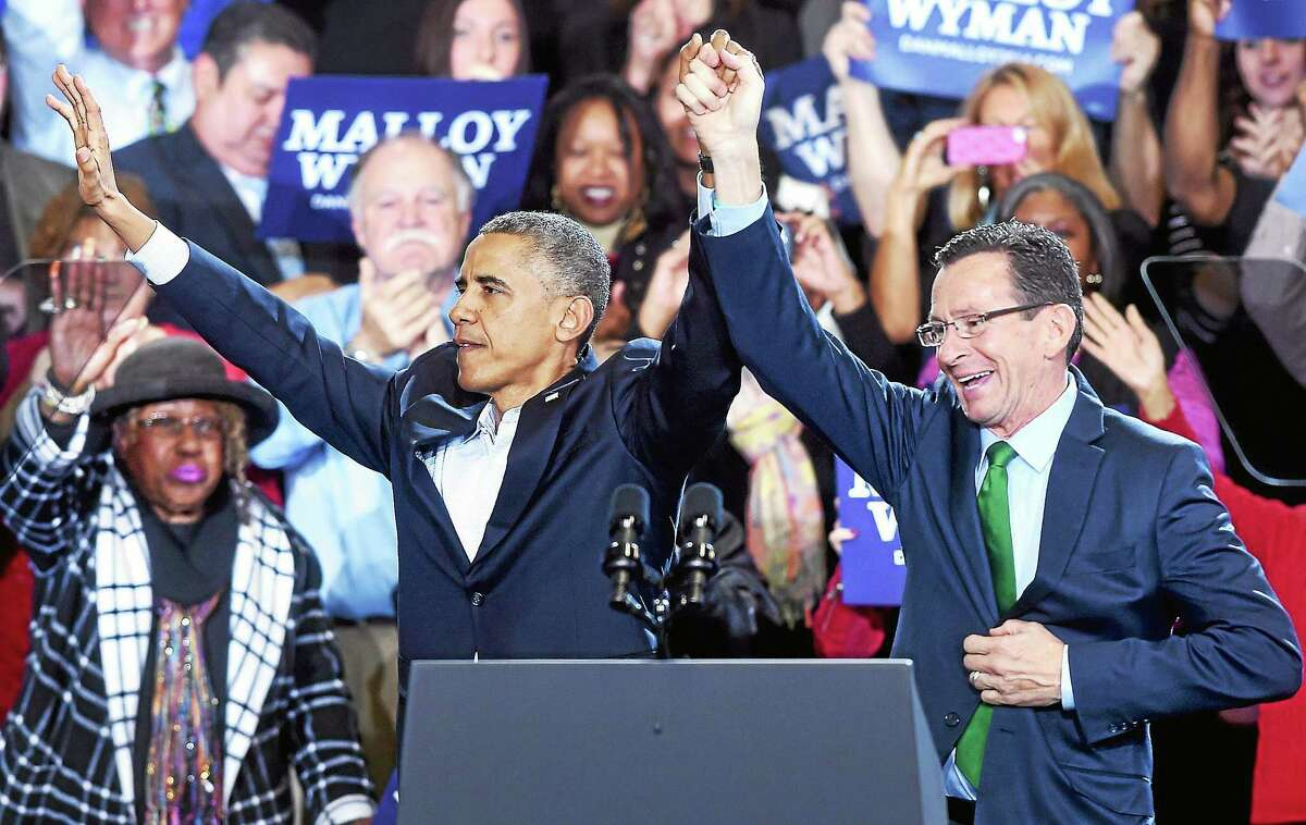 President Barack Obama, left, campaigns for Governor Dannel Malloy, right, at Central High School in Bridgeport on November, 2 2014.
