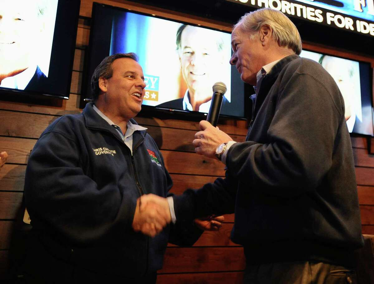 New Jersey Gov. Chris Christie, left, shakes hands with Republican candidate for Connecticut governor Tom Foley at a rally, Monday, Nov. 3, 2014, in Windsor Locks, Conn.