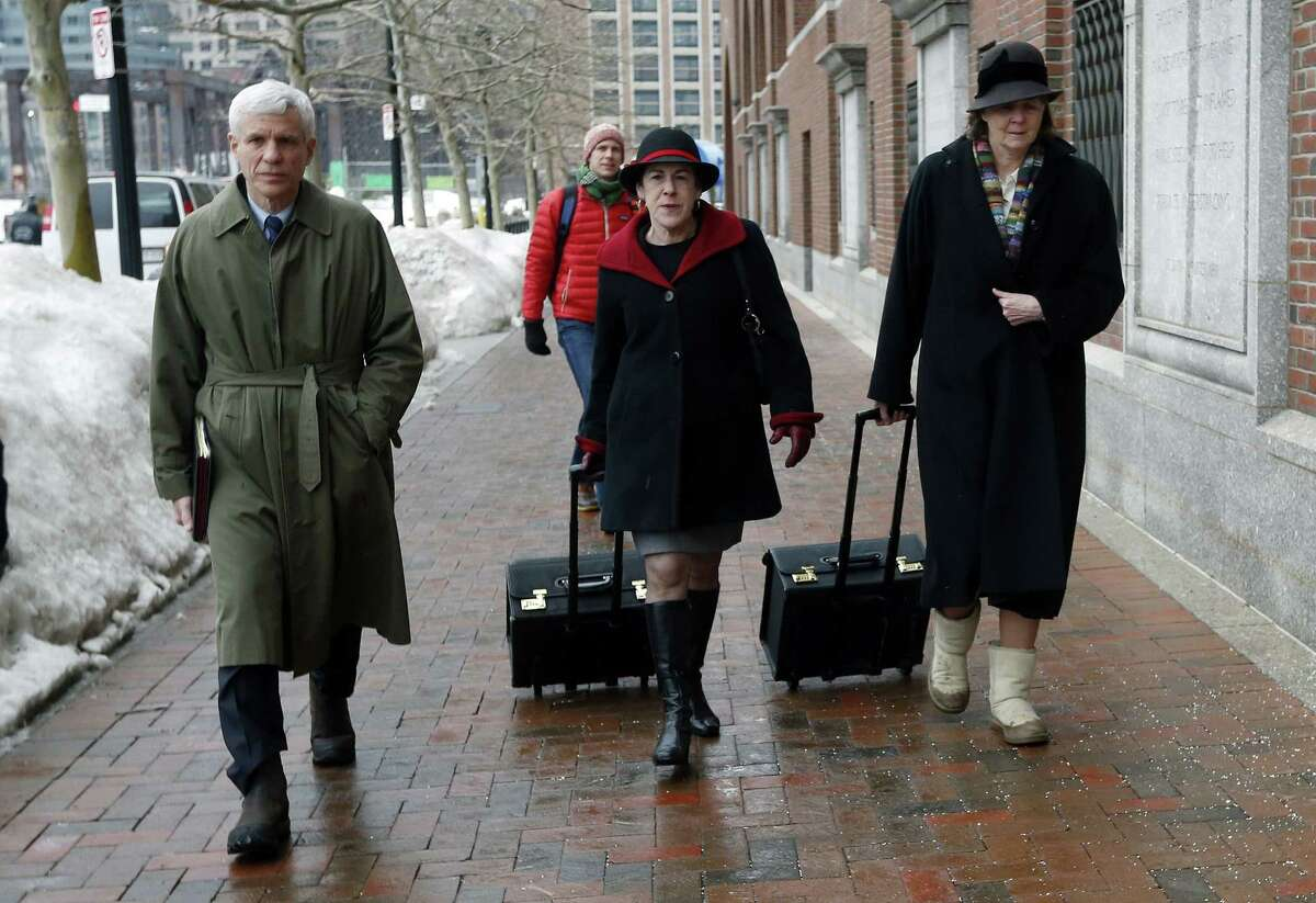 Members of the legal defense team for Boston Marathon bombing suspect Dzhokhar Tsarnaev, including David Bruck, left, Miriam Conrad, center, and Judy Clarke, right, arrive at federal court, Wednesday, March 4, 2015, in Boston, on the first day of Tsarnaev's federal death penalty trial. Tsarnaev is charged with conspiring with his brother to place two bombs near the marathon finish line in April 2013, killing three and injuring 260 people.