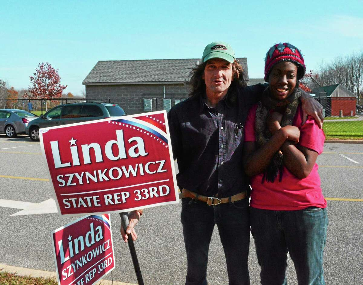 Fred Carroll and Ebony Milling are supporting Republican candidate for state Rep. in the 33rd District Linda Szynkowicz all day at Middletown High School.