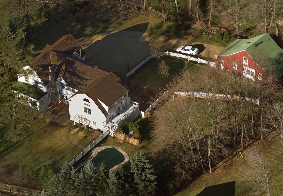 FILE - In this Jan. 5, 2000, file photo, the President Bill Clinton and Hillary Rodham Clinton's home is seen from the air in Chappaqua, N.Y. The server computer that transmitted and received Hillary Clintonís emails on a private account she used exclusively for official business when she was secretary of state traced back to a residential Internet service registered at her familyís five-bedroom home in Chappaqua, according to Internet records reviewed by The Associated Press. (AP Photo/Kathy Willens, File)