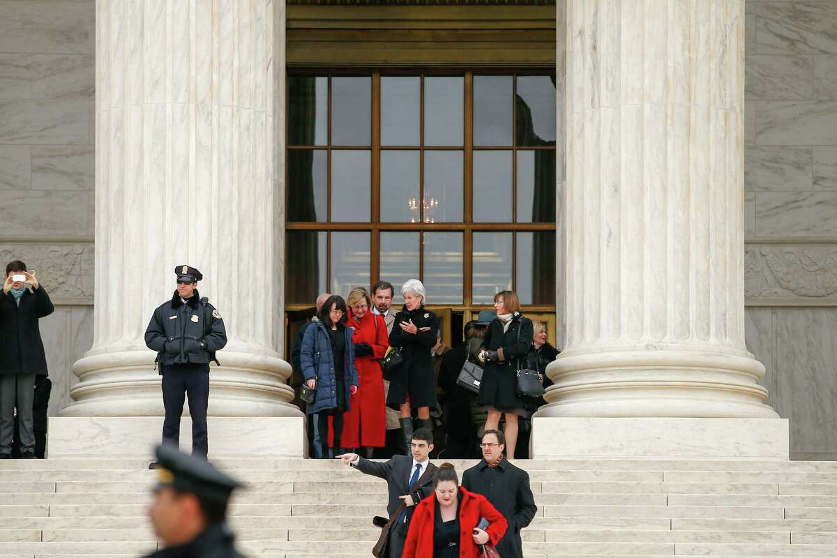 Former Health and Human Services Secretary Kathleen Sebelius, center, exits the Supreme Court in Washington, Wednesday, March 4, 2015. The Supreme Court heard arguments in King v. Burwell, a major test of President Barack Obama's health overhaul which, if successful, could halt health care premium subsidies in all the states where the federal government runs the insurance marketplaces. (AP Photo/Andrew Harnik)