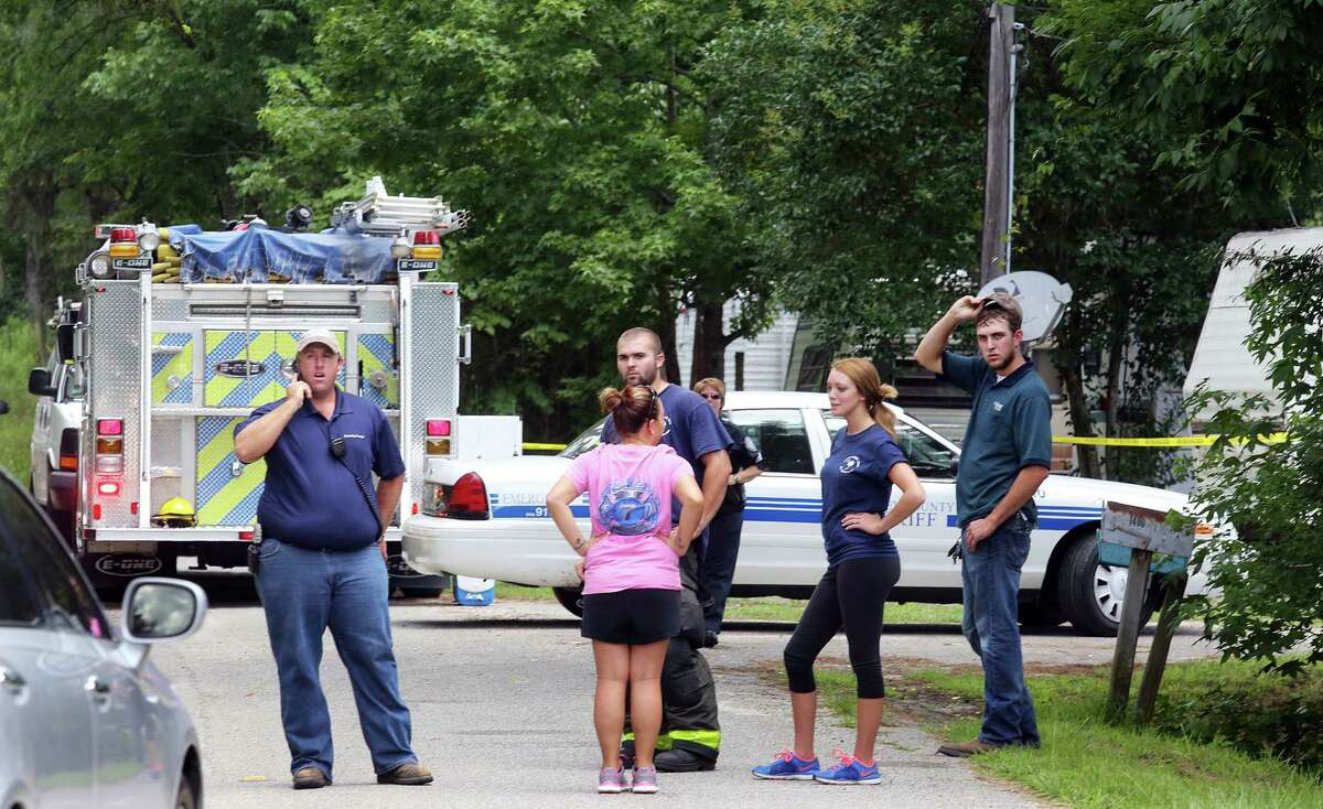 Emergency personnel from Berkeley County stand outside a campground surrounded by police tape near Moncks Corner, S.C., Tuesday, July 7, 2015, after an F-16 fighter jet smashed into a small plane over South Carolina.