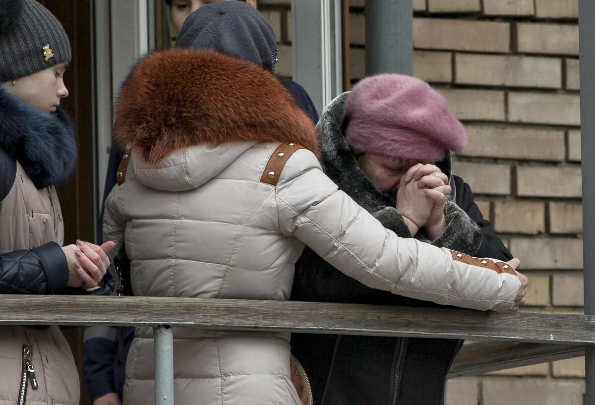 A relative of a miner cries outside the headquarters of the Zasyadko mine in Donetsk, Ukraine, Wednesday, March 4, 2015. An explosion ripped through a coal mine before dawn Wednesday in war-torn eastern Ukraine, killing at least one miner and trapping more than 30 others underground, rebel and government officials said. One injured miner reported seeing five bodies.(AP Photo/Vadim Ghirda)