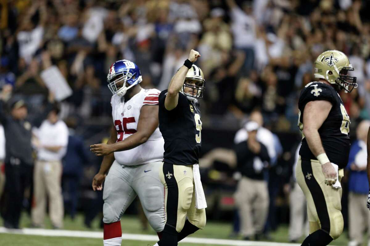 Saints quarterback Drew Brees reacts after throwing a touchdown pass to tie the game late in the second half Sunday.