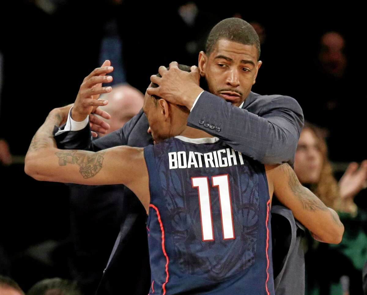 UConn coach Kevin Ollie hugs Ryan Boatright during the second half Friday's win over Iowa State.