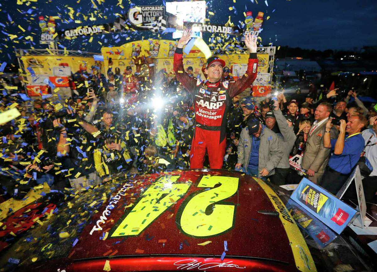 Jeff Gordon celebrates after winning at Martinsville Speedway Sunday.