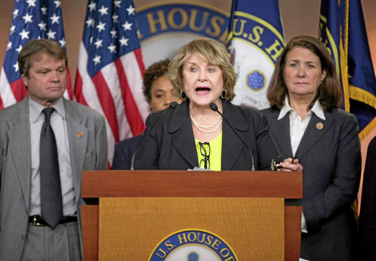 Co-Chair of the Pro-Choice Caucus Rep. Louise Slaughter, D-N.Y., center, speaks during a news conference on Capitol Hill in Washington, Tuesday, March 25, 2014, to discuss the Supreme Court case on whether corporations have religious rights that exempt them from part of the law that requires coverage of birth control for employees. The case being argued at the Supreme Court on Tuesday involves family-owned companies that provide health insurance to their employees, but object to covering certain methods of birth control that they say can work after conception, in violation of their religious beliefs. From left are, Rep. Mike Quigley, D-Ill., Rep. Sheila Jackson Lee, D-Texas, Slaughter, and Rep. Diana DeGette, D-Colo. (AP Photo/ Evan Vucci)