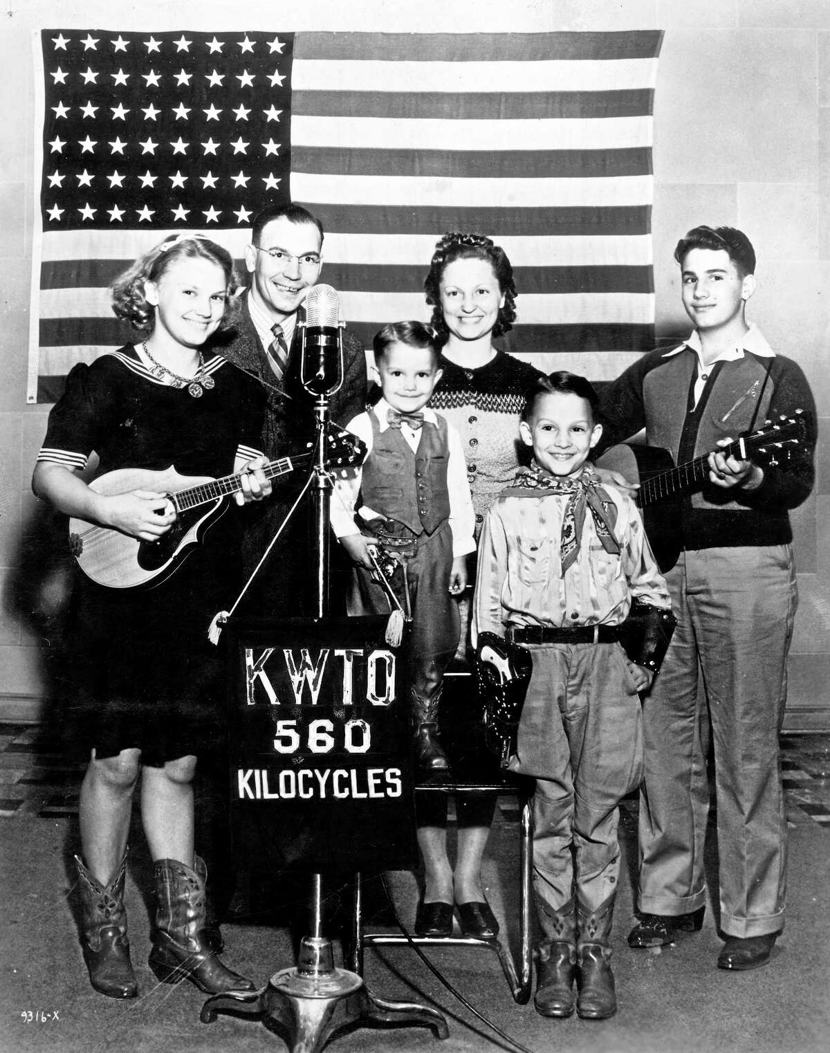 This undated photo provided by Universal Music Group shows Charlie Haden, third from left, posing with the Haden Family band. Haden died Friday, July 11, 2014 in Los Angeles after a long illness. He was 76. (AP Photo/Universal Music Group)