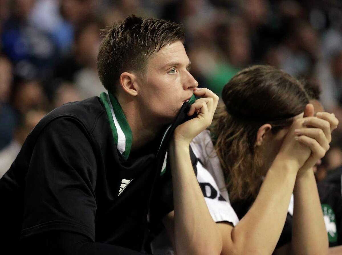 Celtics forward Jonas Jerebko, left, watches from the bench as Kelly Olynyk rests his head on his hands in the second half Sunday.
