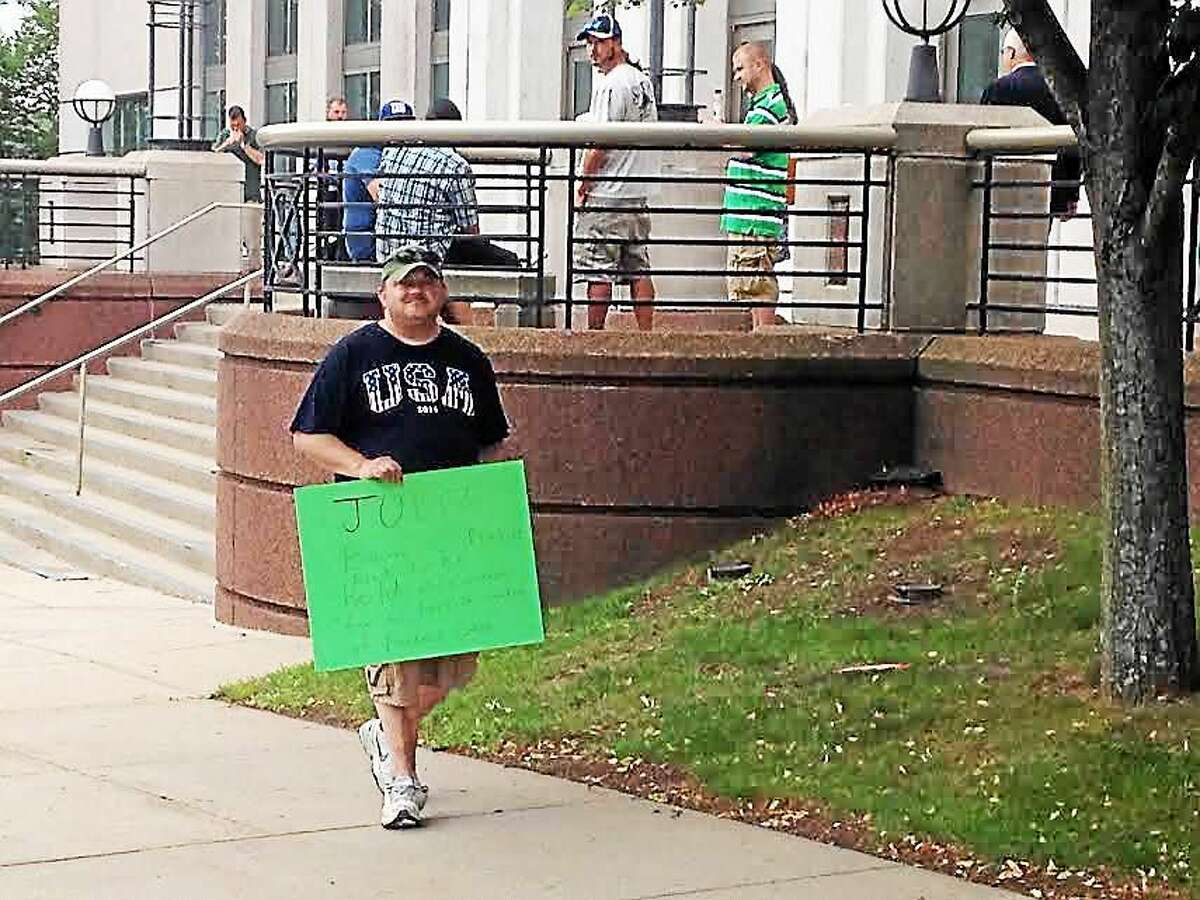 Joe Campbell, 43, protests outside the Middletown Superior Court Thursday morning, as Tony Moreno's court-appointed public defender was appearing before Judge Gold. Campbell said he wants Judge Barry C. Pinkus held accountable for his ruling in the Aaden Moreno custody case.