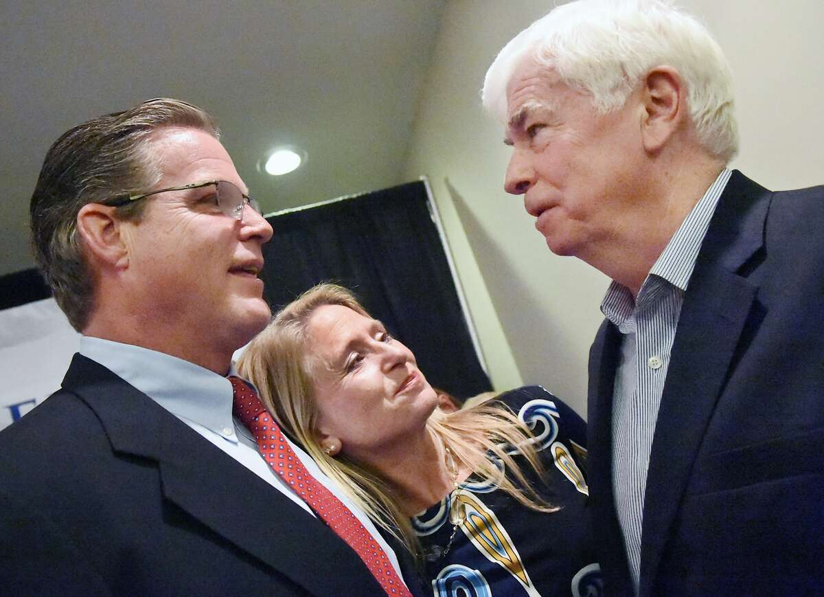 Democrat Ted Kennedy, Jr. and his wife, Dr. Katherine ìKikiî Kennedy speak with former U.S. Senator Chris Dodd about his run for the State Senate seat in Connecticut's 12th District at the Italian American Club of Branford on election day, Tuesday, Nov. 4, 2014.