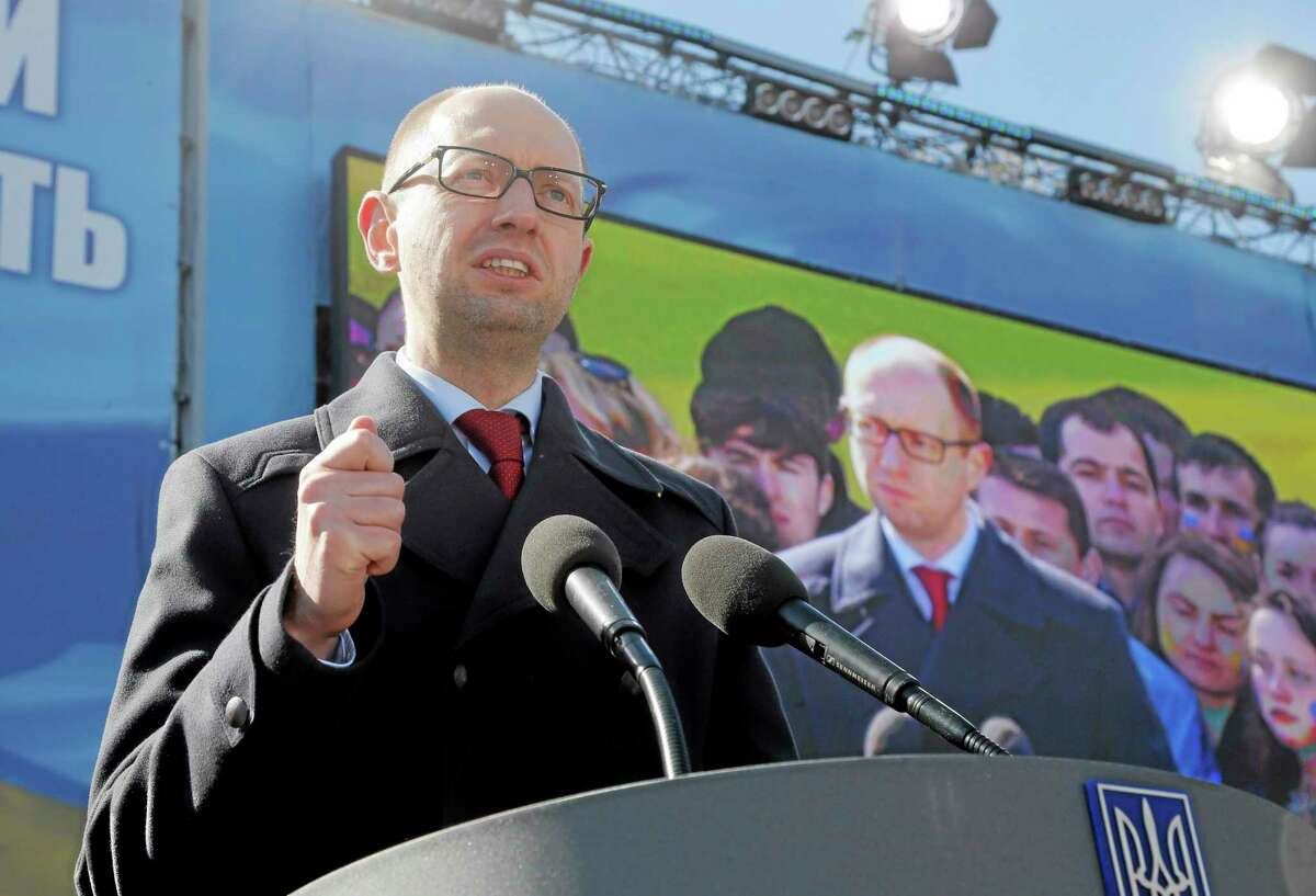 """Ukrainian Prime Minister Arseniy Yatsenyuk delivers his speech, during the Batkivshchina (Fatherland) party congress in Kiev, Ukraine, Saturday, March 29, 2014. Yulia Tymoshenko, declared this week that she will """"be the candidate of Ukrainian unity."""" The May 25 election is taking place against the backdrop of the annexation of Crimea, Ukraine's dire economic straits and rumblings of discontent in the country's mainly Russian-speaking eastern provinces. (AP Photo/Efrem Lukatsky)"""